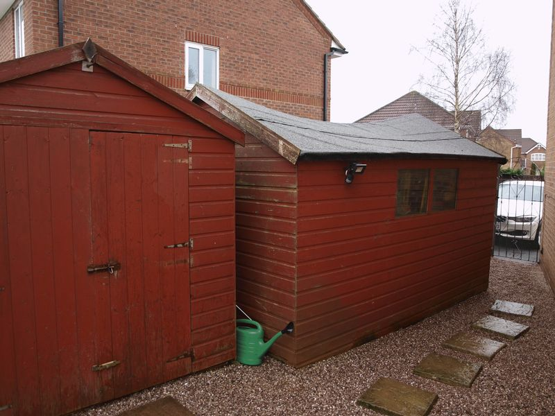 Side Garden With Storage Sheds