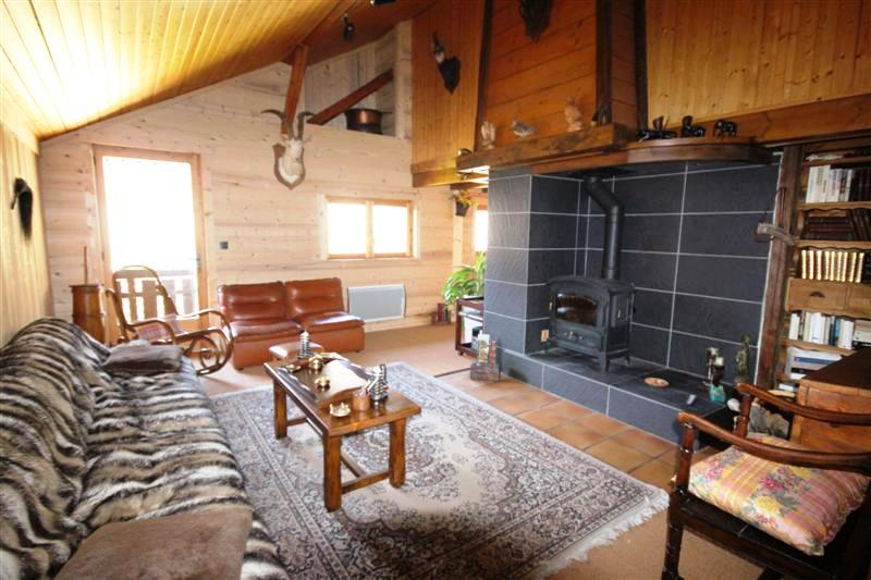 Renovated farmhouse living room with Gaudin woodburner