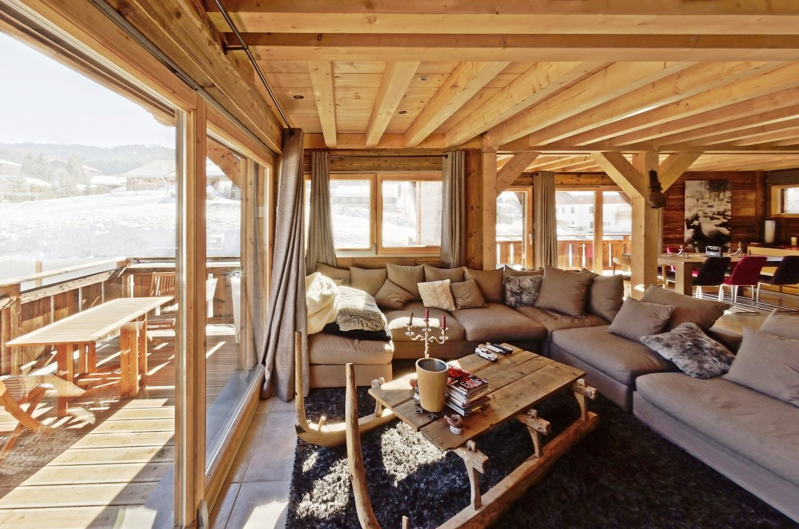 Sitting area and balcony in new Les Gets chalet