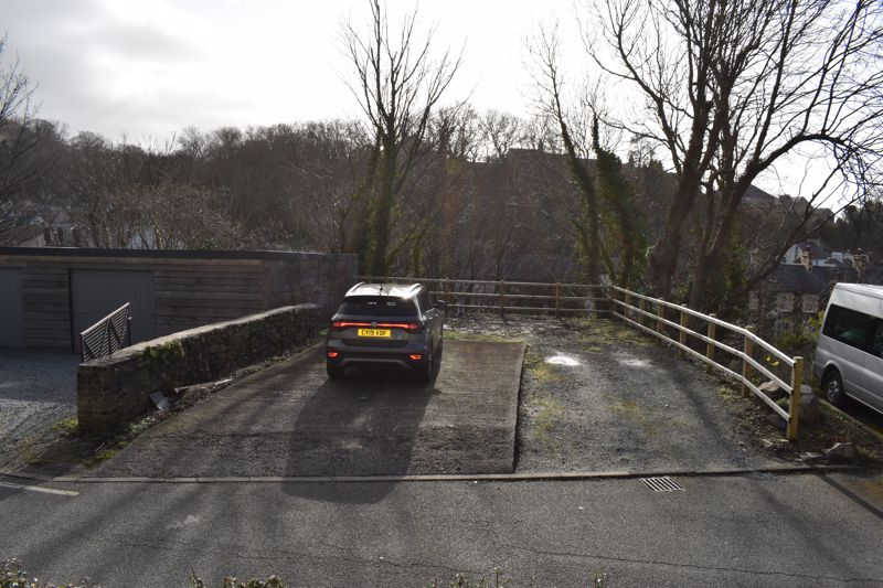 Offroad parking and land opposite house