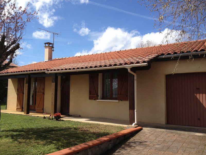 Maison plain pied avec jardin, garage et atelir