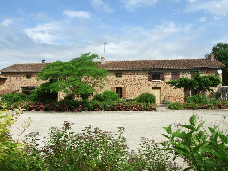 Detached stone house with outbuildings and land suitable for equestrian use