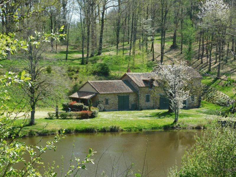 A rare find - renovated watermill, converted to 3 dwellings, on a 2.2 hectare lake