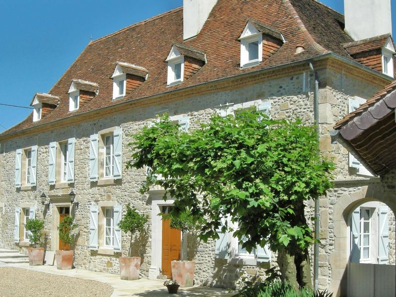 Stunning manor house with outbuildings, pool, 1.3 hectares of land in village location
